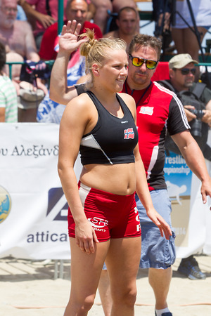 wrestle: KATERINI, GREECE- JULY 6, 2014: Athlete getting ready to wrestle on sand during the First World Championship Beach Wrestling in 2014 in Katerini, Greece.  Editorial