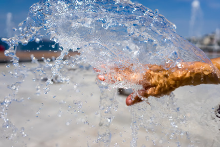 Womans hands with water splash photo