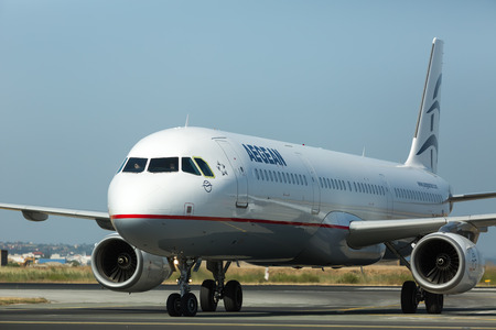 airplane take off: THESSALONIKI, GREECE- MAY 25, 2014: Aircraft operated by Aegean Airlines, ready to take off at International Airport Makedonia, Greece. The company in its fleet has 25 aircraft Airbus-A320 Editorial