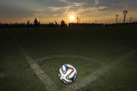 adidas: THESSALONIKI, GREECE  AUGUST 26, 2014: Greek Superleague Brazuca (Mundial) ball on the field during the training of PAOK in Thessaloniki, Greece.
