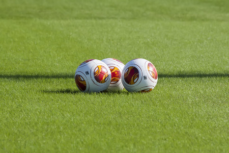 adidas: THESSALONIKI, GREECE – OCTOBER 22, 2013: Europa League balls on the field during the training of PAOK in Thessaloniki, Greece.