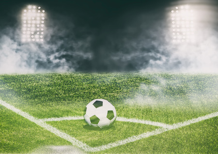 delirious: Soccer ball on the field of stadium with light Stock Photo
