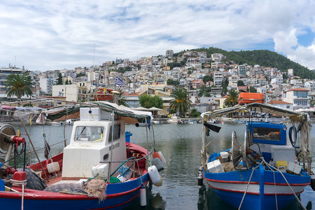 focal point: KAVALA, GREECE- SEPTEMBER 5, 2014: The traditional Greek fishing boats in the harbor of Kavala in Greece. The harbor is the focal point for recreational, commercial, business and tourist activity.