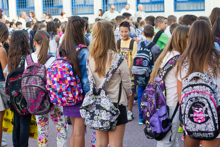 former years: THESSALONIKI, GREECE- SEPTEMBER 11, 2014: Students with their backpacks. First Day of school for the students in Thessaloniki, Greece.