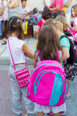 first day: THESSALONIKI, GREECE- SEPTEMBER 11, 2014: Students with their backpacks. First Day of school for the students in Thessaloniki, Greece.