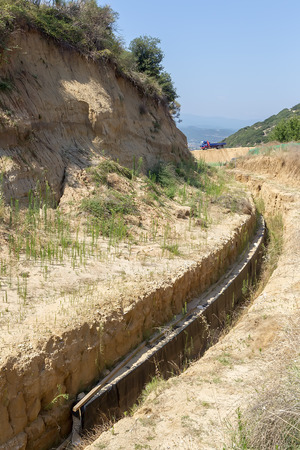 archaeologists: AMPHIPOLI, GREECE- AUGUST 12, 2014: Excavations in Amphipolis, Greece. Archaeologists have uncovered what could be the grave of Alexander the Great at a site near ancient Amphipolis. Stock Photo