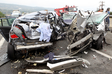 broken car: VERIA, GREECE - OCTOBER, 5, 2014:A large truck crashed into a number of cars and 4 people were killed and many were injured in a multi-vehicle collision that occurred on Egnatia Odos.