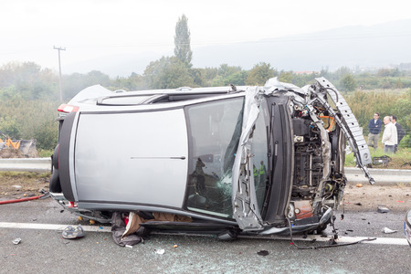 car wreck: VERIA, GREECE - OCTOBER, 5, 2014:A large truck crashed into a number of cars and 4 people were killed and many were injured in a multi-vehicle collision that occurred on Egnatia Odos.