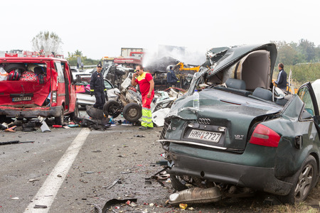 auto glass: VERIA, GREECE - OCTOBER, 5, 2014:A large truck crashed into a number of cars and 4 people were killed and many were injured in a multi-vehicle collision that occurred on Egnatia Odos.