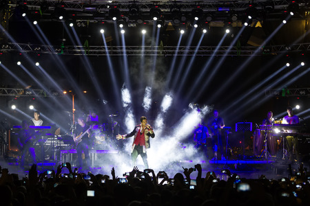 concert stage: THESSALONIKI, GREECE, SEPTEMBER 11, 2014: Singer Sakis Rouvas performing at MAD North Stage festival by HELEXPO (Thessaloniki International Fair).