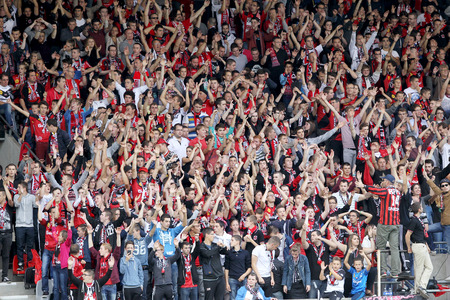 GUINGAMP, FRANCE - OCT 1, 2014 : EA Guingamp fans cheering for their team during the UEFA Europa League match EA Guingamp vs Paok.