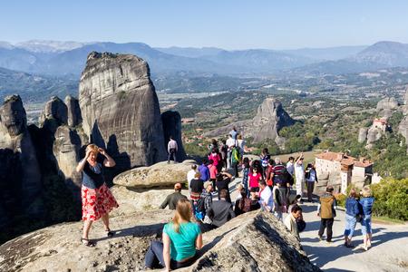 METEORA, GREECE - OCTOBER 12, 2014: Tourists taking pictures during their tour at Meteora, Greece.