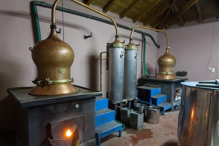 DRAMA, GREECE - NOVEBPER 15,2014: During traditional distillation of alcohol and production of homemade tsipouro/raki