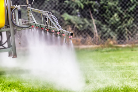 agronomic: Tractors sprayed with fertilizer grass on the pitch