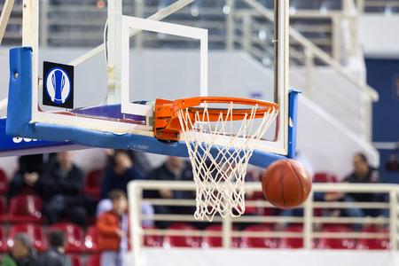 professional basketball league: THESSALONIKI, GREECE - NOV 12, 2014: Basketball ball going through the net prior to Eurocup game Paok vs Buducnost