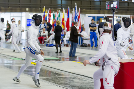 fencers: THESSALONIKI, GREECE - OCT 19, 2014 : Young athletes competing during the World Youth Fencing Championships 2014. Over 150 fencers from 25 countries took part at the championships.