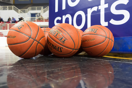 professional basketball league: THESSALONIKI, GREECE - NOV 12, 2014: Basketball balls stacked prior to the Eurocup game Paok vs Buducnost Editorial