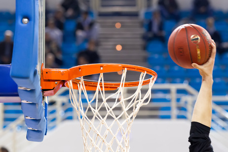 professional basketball league: THESSALONIKI, GREECE - NOV 12, 2014: Undefined player hands throwing a ball through the net prior to Eurocup game Paok vs Budocnost Editorial