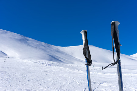 stuck up: Ski poles on the mountain Falakro, in Greece. Stock Photo