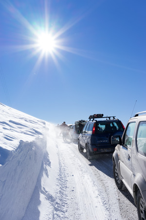 visitors area: FALAKRO, GREECE - FEBRUARY 11, 2013: Visitors waiting near their cars for the Snowmobile to remove the snow from the road in Falakro, Greece. Falakro Mountain is located in the area of Dramas. Editorial