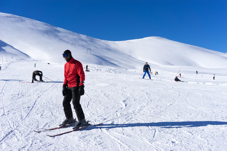 FALAKRO, GREECE - FEBRUARY 11, 2013: Skier skiing on the mountain of Falakro, Greece. The ski resort of Falakro Mountain is located in the area of Dramas.