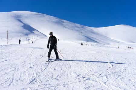 dramas: FALAKRO, GREECE - FEBRUARY 11, 2013: Skier skiing on the mountain of Falakro, Greece. The ski resort of Falakro Mountain is located in the area of Dramas.
