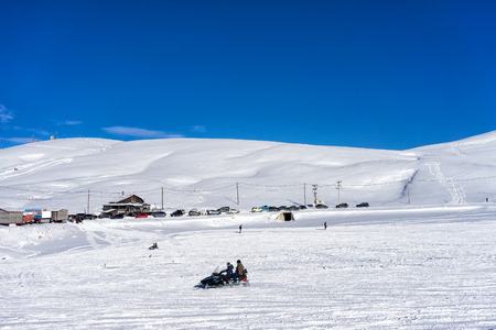 dramas: FALAKRO, GREECE - FEBRUARY 11, 2013: Visitors enjoy the snow on snowmobiles in Falakro ski center, Greece. The ski resort of Falakro Mountain is located in the area of Dramas. Editorial