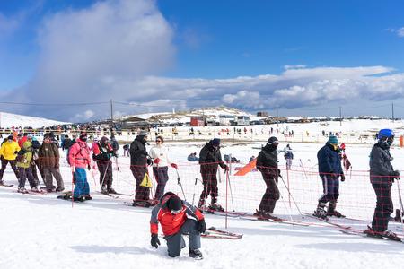 recently: KAIMAKTSALAN, GREECE - FEBRUARY 13, 2014: Skiers enjoy the snow at Kaimaktsalan ski center, in Greece. Recently at the ski center every lift has its automatic ticketing system.