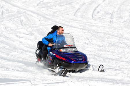 FALAKRO, GREECE - FEBRUARY 11, 2013: Visitors enjoy the snow on snowmobiles in Falakro ski center, Greece. The ski resort of Falakro Mountain is located in the area of Dramas. Editorial