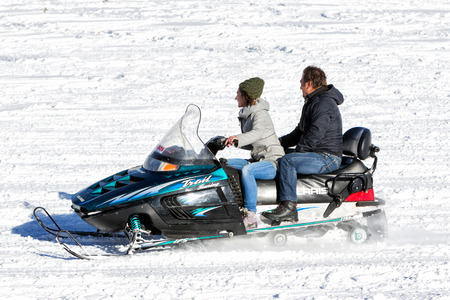 visitors area: FALAKRO, GREECE - FEBRUARY 11, 2013: Visitors enjoy the snow on snowmobiles in Falakro ski center, Greece. The ski resort of Falakro Mountain is located in the area of Dramas. Editorial