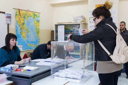 accordance: THESSALONIKI, GREECE, JANUARY 25, 2015: Highlights during Greek General Election 2015. Greeks are voting on Sunday to elect the 300 members of the parliament in accordance with the constitution.