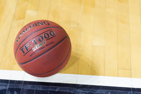 thessaloniki: THESSALONIKI, GREECE - JAN 21, 2015: Basketball ball on the ground prior to the Eurocup game Paok vs Khimki in Paok Sports Arena.