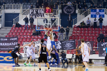thessaloniki: THESSALONIKI, GREECE - JAN 21, 2015: Tyler Honeycutt of Khimki in action during the Eurocup game Paok vs Khimki in Paok Sports Arena.