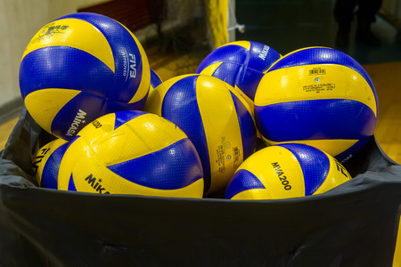 thessaloniki: THESSALONIKI, GREECE - FEBRUARY 5, 2015 : Volleyball balls stacked during the Hellenic Volleyball League game Paok vs Aris at PAOK Sports Arena. Editorial