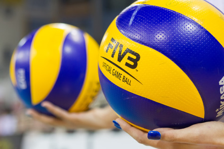 hellenic: THESSALONIKI, GREECE - FEBRUARY 5, 2015 : Closeup of hands holding a volleyball ball during the Hellenic Volleyball League game Paok vs Aris at PAOK Sports Arena. Editorial