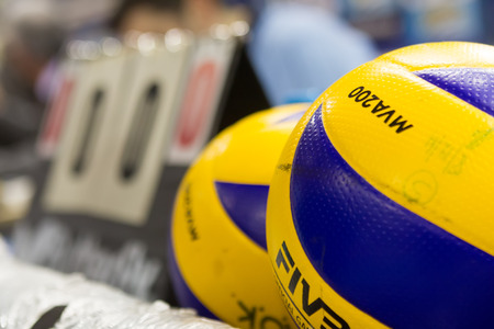 thessaloniki: THESSALONIKI, GREECE - FEBRUARY 5, 2015 : Closeup of hands holding a volleyball ball during the Hellenic Volleyball League game Paok vs Aris at PAOK Sports Arena. Editorial