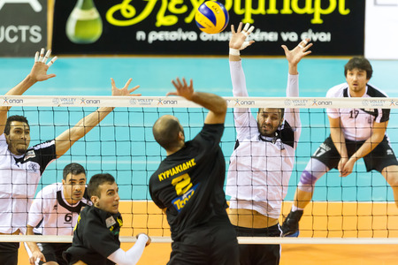hellenic: THESSALONIKI, GREECE - FEBRUARY 5, 2015 : The team players in action on the net during the Hellenic Volleyball League game Paok vs Aris at PAOK Sports Arena.