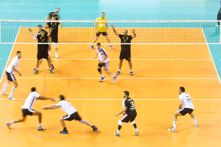 thessaloniki: THESSALONIKI, GREECE - FEBRUARY 5, 2015 : General view of the Hellenic Volleyball League game Paok vs Aris at PAOK Sports Arena with motion blur on players.