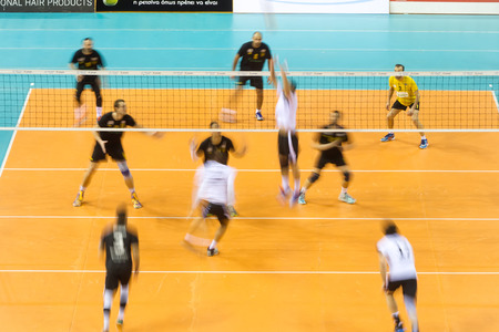hellenic: THESSALONIKI, GREECE - FEBRUARY 5, 2015 : General view of the Hellenic Volleyball League game Paok vs Aris at PAOK Sports Arena with motion blur on players.