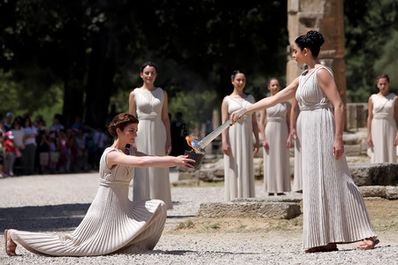 OLYMPIA , GREECE, MAY 9, 2012: High Priestess, the Olympic flame during the Torch lighting ceremony of the Olympic Games in London in 2012 at ancient Olympia