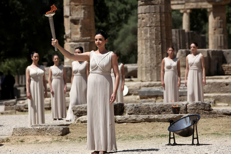 priestess: OLYMPIA , GREECE, MAY 9, 2012: High Priestess, the Olympic flame during the Torch lighting ceremony of the Olympic Games in London in 2012 at ancient Olympia