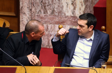 the prime minister: ATHENS, GREECE - FEBRUARY 18,2015: Prime Minister Alexis Tsipras (R) talks with Finance Minister Yanis Varoufakis (L) at the Parliament during the voting session for President of Greece Editorial