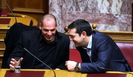 prime minister: ATHENS, GREECE - FEBRUARY 18,2015: Prime Minister Alexis Tsipras (R) talks with Finance Minister Yanis Varoufakis (L) at the Parliament during the voting session for President of Greece Editorial