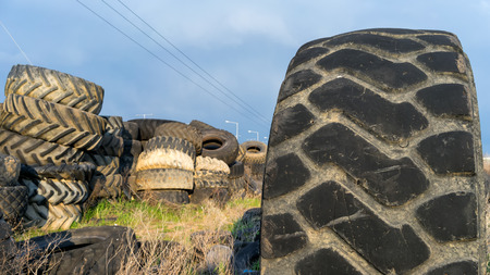 disposed: Numerous tires stacked on top of each other Stock Photo