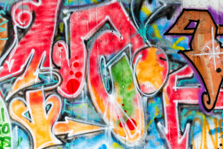 THESSALONIKI, GREECE, MARCH 23, 2015: Colorful graffiti art line the street walls Editorial
