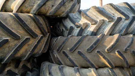 Numerous tires stacked on top of each other photo