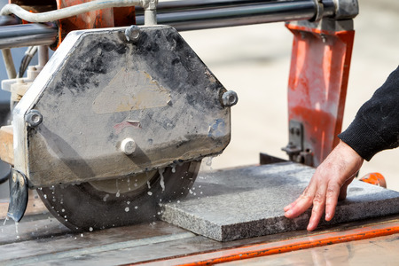 stone cutter: Workers are working, cutting marble cutter Stock Photo