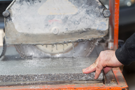 Workers are working, cutting marble cutter photo