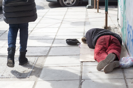 destitute: THESSALONIKI, GREECE, MARCH 28,2015: Homeless in Greece face continuing financial crisis. Homeless of Thessaloniki often begging for food or money, sleeping rough outside shops or in public parks
