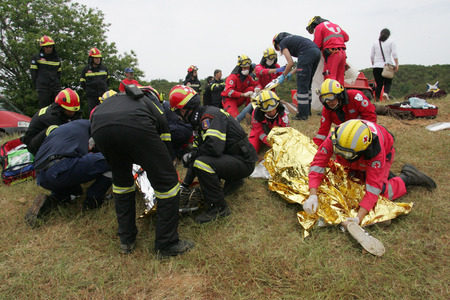 rescuing: ILIA,GREECE,MAY 21,2015:Pan-European exercise of the Fire Brigade with evacuation and village houses complex, stalking and arson suspects arrested them, rescuing injured firefighters and citizen